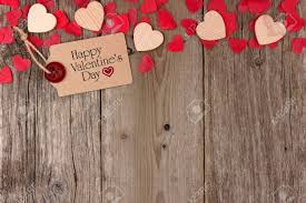 Happy Valentines Day Gift Tag With Scattered Wooden Hearts And Confetti Top Border On A Rustic