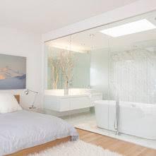 master bedroom with open bathroom
