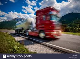 100 Atlantic Trucking Fuel Truck Rushes Down The Highway In The Background The