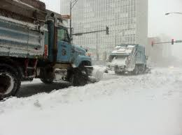 File:Retrofitted Garbage Trucks With Snowplows Shoveling Snow On ...