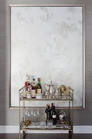 Gray Dining Room With Brass Bar Cart And Abstract Art