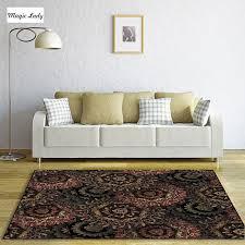 teppich mit blumen retro vintage grunge altmodischen blumenmuster kunst rund spirale blütenblätter wohnzimmer schlafzimmer braun schwarz