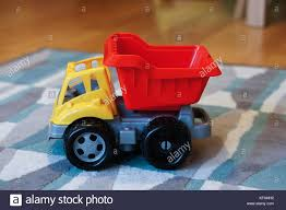 Plastic Toy Truck On A Carpet Stock Photo: 164349614 - Alamy Amazoncom Small World Toys Sand Water Peekaboo Dump Truck You Can Pile 180kg Of Into This Oversized Plastic American Gigantic Fire Trucks Cars Free Images Antique Retro Transport Truck Red Vehicle Mood Colourful Plastic Toy On Ground Stock Photo Royalty Toystate Cat Tough Tracks 8 Games My First Tonka Mini Wobble Wheels Garbage Toysrus Wwii Toy Soldiers German Cargo And Stuff Pyro Army Soldier Aka Troop Transport Orange For Kids Isolated White Background Bright On White Ride Shop The Exchange