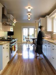 galley kitchen lighting with laminate flooring and breakfast nook