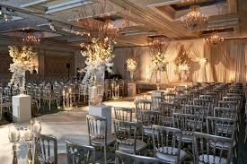 Jewish Wedding Ceremony At Hotel In Chicago With Silver Chair White Flower Branch Details