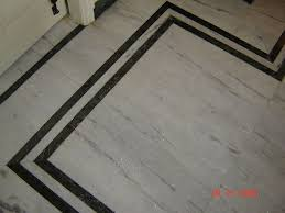 White Marble Flooring With Green Borders