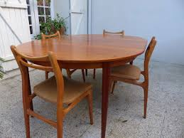 Scandinavian Dining Table In Teak - 1960s - Design Market Mid Century Modern Scdinavian Round Ding Table In Teak For Sale Kfoed Hornslet Danish Solid Extendable 8 Eva Fniture Minimalist And Cool Fniture Set Of Six High Back Anders Jsen Style Windsor Vintage Ding Room Set In Teak Design Market Vejle Stole Draw Leaf Midcentury Chairs Room Dectable Black Found Midcentury Youtube Edward Valtinsen Scandinavia Woodworks 6 Luxury Ideas Also Simple