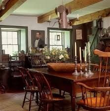FARMHOUSE INTERIOR Vintage Early American Farmhouse Showcases Raised Panel Walls Barn Wood Floor Colonial DecoratingFarmhouse