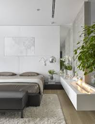 Fireplace And Plants In Small Bedroom By Alexandra Fedorova