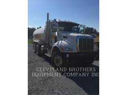 Peterbilt 348 WT - Dump Trucks - Transport - CATERPILLAR WORLDWIDE