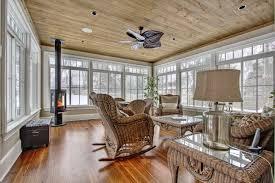 Rustic Sunroom Antique Wood Floor Burning Stove Wicker Furniture Paneling
