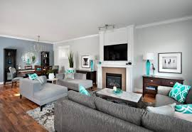 modern living room with grey furniture and turquoise accents