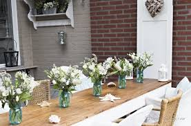 A Line Up Of Blue Mason Jars With Bouquets Randomly Chosen White Flowers Just