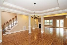 From The Great Room You Can See Into Two Front Door Foyer With Hardwood Staircase Chair Rail Keeps Dining Space Formal