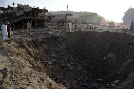 Image Afghan Security Forces And Residents Stand Near The Crater From A Powerful Truck Bomb