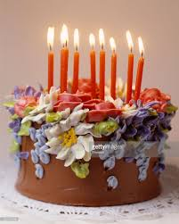 Chocolate Birthday Cake with Icing Flowers & Lit Candles Stock