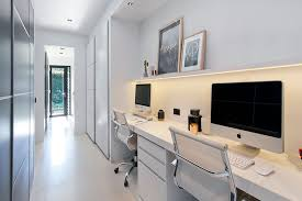 With Enough Room For Two This Large Desk Sits Below A Small Floating Shelf Hidden Lighting While The Long White Hallway Provides Perfect Space