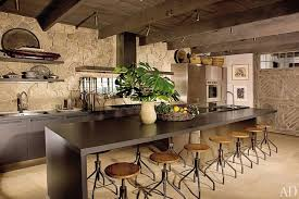 A Stone Wall Ceiling Beams And Barnlike Door Add Rustic Touches To The