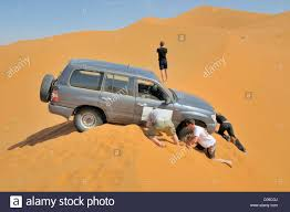 Car Stuck In Sand Stock Photos & Car Stuck In Sand Stock Images - Alamy Truck Driver Digging Stuck Out Of Sand Scooping It Away From Gps Points Driver In Wrong Direction Leading Him To Beach A Landrover Stuck Soft Sand Stock Photo 83201672 Alamy Africa Tunisia Nr Tembaine Land Rover Series 2a Cab Offroad 101 Bugout Vehicle Basics Recoil Driving Tips Heres How Get Out Photos Ram Still Dont Need Crawl Control Youtube The Stock Image Image Of Field 48859371 4x4 Car Photo Transportation 3 Ways Drive Mud Wikihow