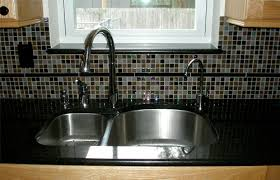 brown glass mosaic tile back splash with stainless sink modern