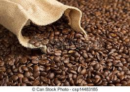 Jute Bag On Background Of Coffee Beans Stock Photo