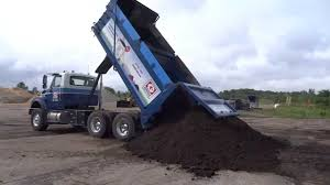 Greely Sand & Gravel Unloading A Full Tandem Load Of Topsoil - YouTube