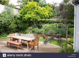 A Wooden Picnic Table Waits For The Guests In A Landscaped ... Summer Backyard Pnic 13 Free Table Plans In All Shapes And Sizes Prairie Style Pnic Outdoor Tables Pinterest Pnics Style Stock Photo Picture And Royalty Best Of Patio Bench Set Y6s4r Formabuonacom Octagon Simple Itructions Design Easy Ikkhanme Umbrella Home Ideas Collection We Go On Stock Image Image Of Benches Family 3049 Backyards Ergonomic With Ice Eliminate Mosquitoes In Your Before Lawn Doctor