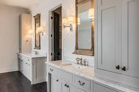 gray cottage bathroom with neoclassical window mirrors and