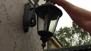 how to change an outdoor porch lantern sconce light bulb simple