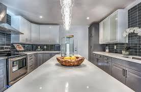 gray kitchen cabinets with white quartz countertops trekkerboy