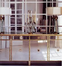 In A Mid Century Dining Room Mirror On Blurs The Lines Between Reflection And Transparency