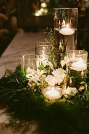 Layered floating candles with wreath Wedding