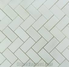white marble herringbone mosaic tile bathroom floor backsplash