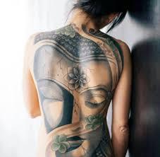 Cool Back Tattoo Of Asian Buddha On Girl