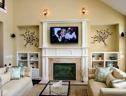 cream fireplace with white shelf and tv above on the middle of