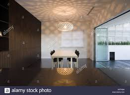 Pendant Light Above Table And Chairs In Modern Minimalist Dining Room