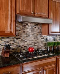 Modern Kitchen with Simple granite counters & Mosaic tile