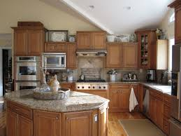 Kitchen Brown Wooden Cabinet And Grey Granite Islands Top Connected By Beige Tile