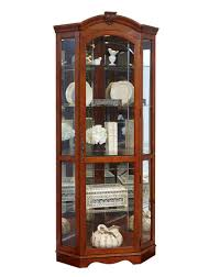 corner curio cabinet in medallion cherry by pulaski home gallery