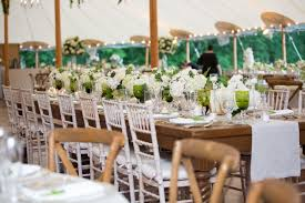 Tent Wedding Reception With Long Kings Tables Green Goblets Glassware Wood Chairs White Runner Rustic