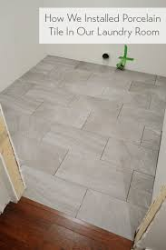 laying porcelain tile in the laundry room house
