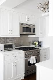 kitchen with gray mini brick tile backsplash transitional