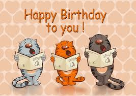 "Enjoy a motion image of three cartoon cats singing ""Happy Birthday to you"""