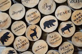 See How Easy It Is To Create These Rustic Cabin Inspired Christmas Ornaments From Wood Slices