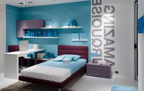 Atrractive Blue Teenage Girl Room Design With Letter Wallpaper And Floating Cabinet On The Wall Above White Table As Well Maroon Bed Frame Plus