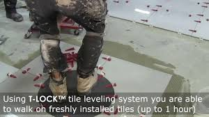 new way of tile installation you walk on just installed tiles