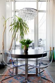 Amazing Eclectic Diningroom Round Dining Table With White Curtains Clear Chairs Kilim Rug