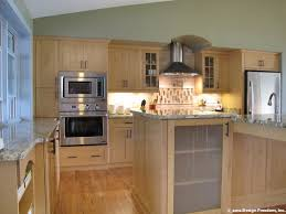 Kitchen with stainless steel appliances and light wood cabinetry