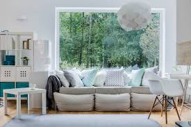 Grey Sofa Loaded With Light Blue White And Pillows