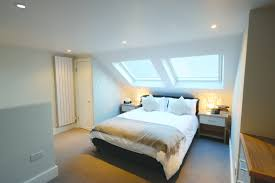 loft conversions bedroom in sw18 with velux windows with a